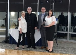 Debbie [right] receiving her award, pictured with Anne Manning, Conrad Mielcuszny and Casey Smallwood